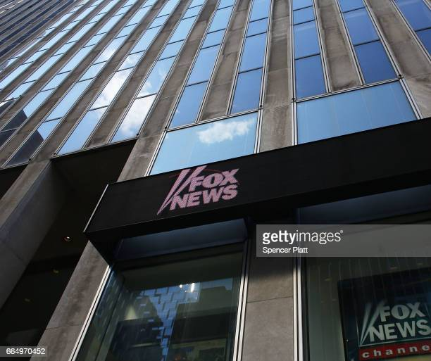 The News Corporation headquarters owner of Fox News stands in Manhattan on April 5 2017 in New York City Following allegations that he sexually...