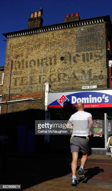 The newspaper advertisement in southwest London which has been quietly fading on a building's brick wall for the better part of a century and was...
