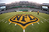 The NFL shield is painted in gold and black after a game between the Cleveland Browns and the New York Jets at MetLife Stadium on September 13 2015...
