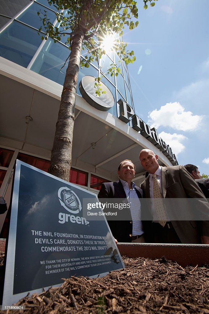 The NHL Green initiative plaque is seen as NHL commissioner Gary Bettman poses with former hockey player and three-time Stanley Cup champion Ken Daneyko after the New Jersey Legacy Tree Project Press Conference at Prudential Center on June 29, 2013 in Newark, New Jersey. As part of the NHL's commitment to support the local environment of host cities for NHL events through its NHL Green initiative, the NHL Foundation has donated 30 trees to the Devils Care Foundation.