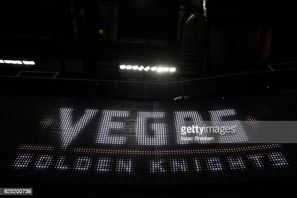 The NHL unveils the new logo and name for the Vegas Golden Knights displayed on screens inside TMobile Arena November 22 2016 in Las Vegas Nevada The...