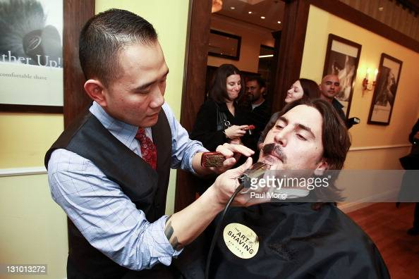 The NHL's Anaheim Ducks player George Parros getting a shave at the Anaheim Ducks Movember KickOff event at The Art Of Shaving on October 31 2011 in...