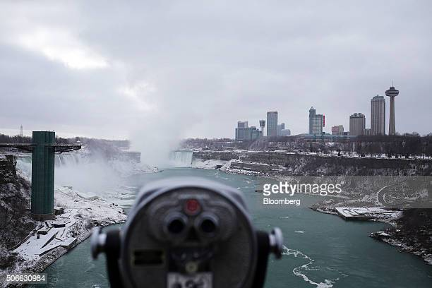 The Niagara Falls are seen standing in between Canada right and the United States left in this photograph taken from the Rainbow Bridge in Niagara...