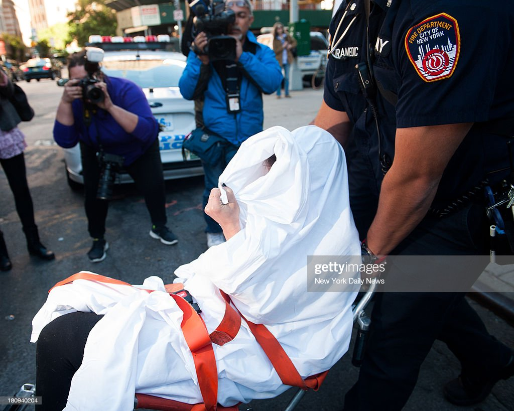The niece of Vice President Joe Biden, Caroline Biden, 26, is wheeled into an ambulance after scuffling with police. Caroline was taken into police custody Tuesday morning in Manhattan after tussling with cops sent to break up a fight with her roommate over rent money. Biden was hospitalized after apparently fallin ill at the 1st Precinct stationhouse.