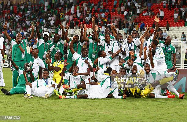 The Nigeria team celebrate their victory with their trophies after the FIFA World Cup UAE 2013 Final between Nigeria and Mexico at Mohamed Bin Zayed...