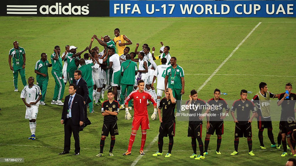 The Nigerian celebrate victory after beating Mexico 3-0 in the FIFA U-17 World Cup UAE 2013 Final between Nigeria and Mexico at the Mohamed Bin Zayed Stadium on November 8, 2013 in Abu Dhabi, United Arab Emirates.
