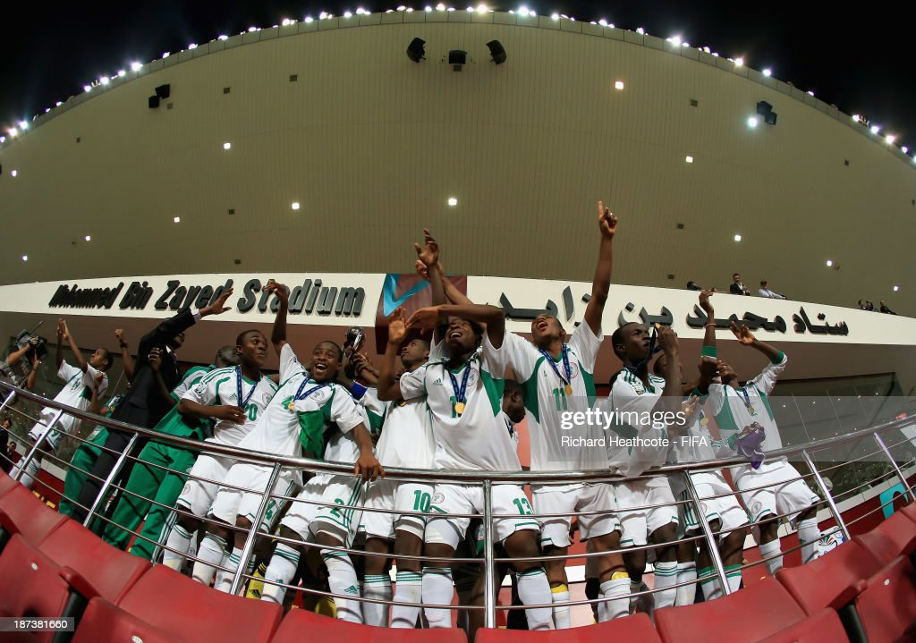 The Nigerian team lift the trophy after beating Mexico 3-0 in the FIFA U-17 World Cup UAE 2013 Final between Nigeria and Mexico at the Mohamed Bin Zayed Stadium on November 8, 2013 in Abu Dhabi, United Arab Emirates.