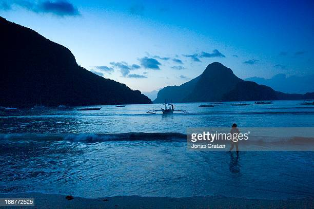 EL NIDO PALAWAN PHILIPPINES The night falls over El Nido as the last swimmer gets out of the water El Nido is a municipality located at the...