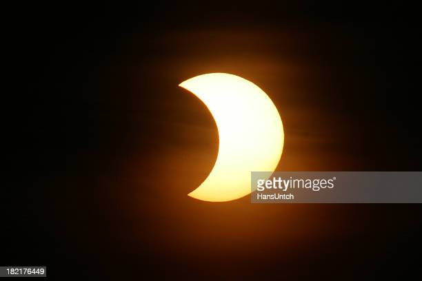 The nights sky with a partial solar eclipse