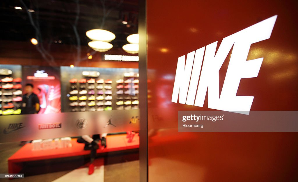 The Nike Inc. logo is displayed at the entrance to the company's store in the East Nanjing Road shopping area of Shanghai, China, on Friday, Feb. 1, 2013. China's services industries grew at the fastest pace since August as gains in retailing and construction aid government efforts to drive a recovery in the world's second-biggest economy. Photographer: Tomohiro Ohsumi/Bloomberg via Getty Images