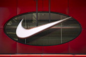 The Nike Inc logo is displayed on the front of the Niketown store in downtown San Francisco California US on Wednesday June 15 2011 Retailers such as...