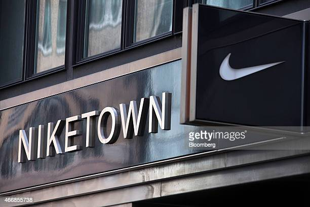 The Nike Inc logo is displayed outside a Niketown store in New York US on Wednesday March 18 2015 Nike is scheduled to release a thirdquarter...