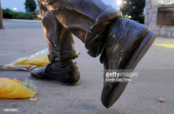 The Nike logo is prominent on the shoes of Joe Paterno's statue outside of Beaver Stadium on Thursday July 12 in State College Pennsylvania A news...