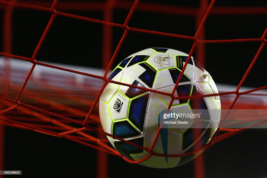 The Nike matchball lands on the goal netting during the Barclays Premier League match between Liverpool and Burnley at Anfield on March 4 2015 in...