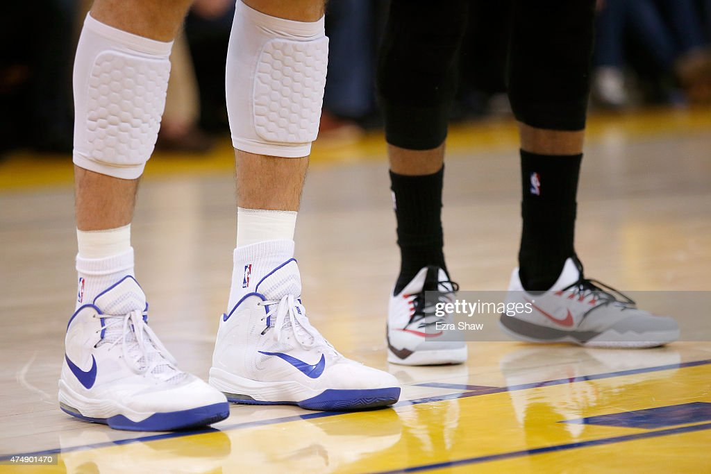 The NIKE shoes of Andrew Bogut of the Golden State Warriors and James Harden of the Houston Rockets are seen during game five of the Western...