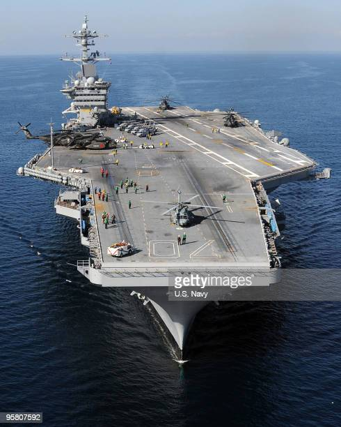 The Nimitzclass aircraft carrier USS Carl Vinson awaits the return of Carrier Air Wing 17 aircraft along the coast of Haiti Carl Vinson and Carrier...