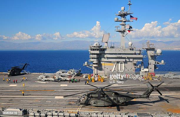 The Nimitzclass aircraft carrier USS Carl Vinson shown operating off the coast of Haiti on January 15 2009 in PortAuPrince Haiti The US military is...