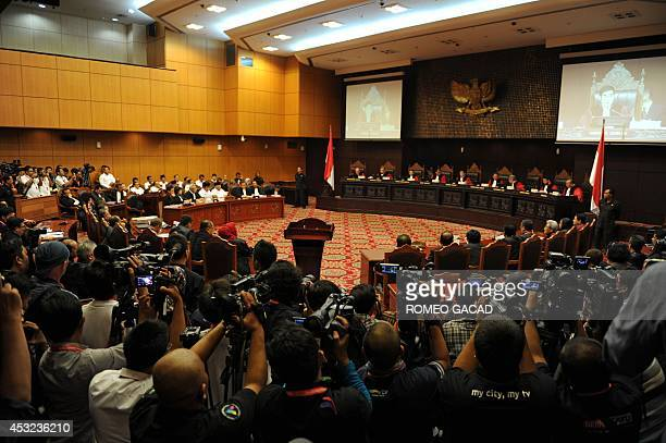 The ninejudge panel of Indonesia's Constitutional Court gather to hear a legal complaint by losing presidential candidate Prabowo Subianto and...