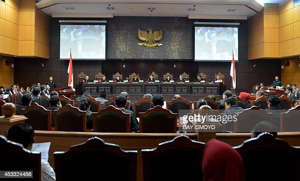 The ninejudge panel of Indonesia's Constitutional Court listens to presidential candidate Prabowo Subianto's defense counsel address the resumption...