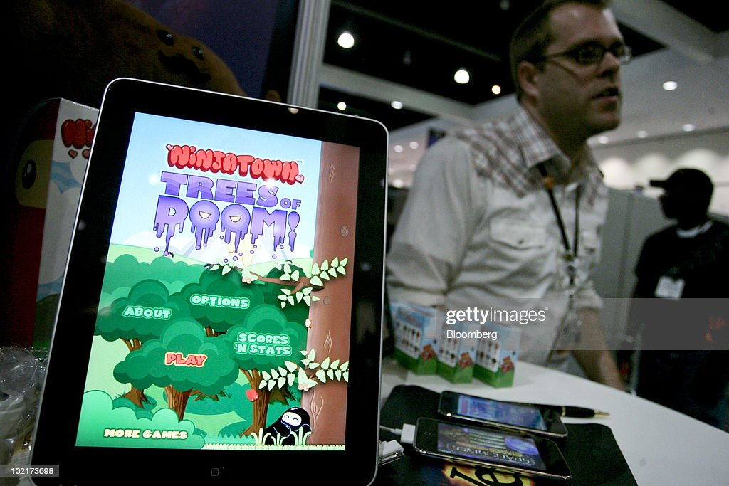 The Ninjatown Trees of Doom game is displayed on an Apple iPad tablet during the Electronic Entertainment Expo (E3) in Los Angeles, California, U.S., on Wednesday, June 16, 2010. Sales of iPhone, iPod Touch and iPad, all of which can be used to play games, will reach 100 million units this month, Chief Executive Officer Steve Jobs said in May. Photographer: Jonathan Alcorn/Bloomberg via Getty Images