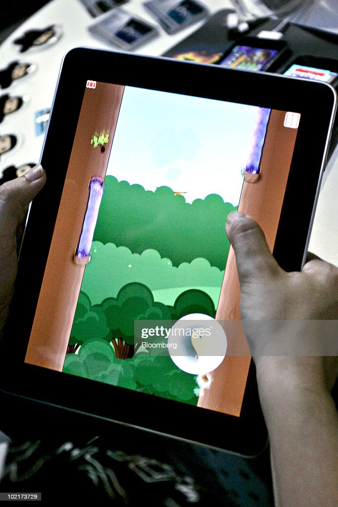 The Ninjatown Trees of Doom game is played on an Apple iPad tablet during the Electronic Entertainment Expo (E3) in Los Angeles, California, U.S., on Wednesday, June 16, 2010. Sales of iPhone, iPod Touch and iPad, all of which can be used to play games, will reach 100 million units this month, Chief Executive Officer Steve Jobs said in May. Photographer: Jonathan Alcorn/Bloomberg via Getty Images