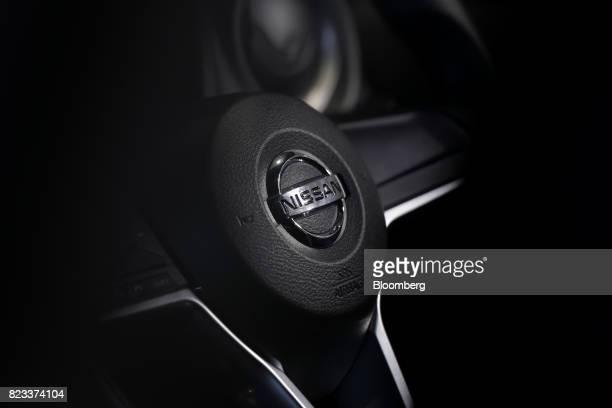 The Nissan Motor Co badge is displayed on the steering wheel of a Note ePower hybrid vehicle at the company's showroom in Yokohama Japan on Thursday...