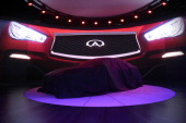The Nissan Motor Co Infiniti Q50 Eau Rouge concept vehicle sits covered before being unveiled during the the 2014 North American International Auto...