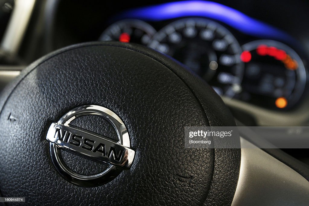 The Nissan Motor Co. logo is displayed on the steering wheel of a Note Medalist vehicle at the company's showroom in Yokohama, Kanagawa Prefecture, Japan, on Friday, Feb. 8, 2013. Nissan, Japan's second-biggest carmaker, reported third-quarter profit that fell short of analysts' estimates, after sales tumbled in China and new models trailed competitors in the U.S. Photographer: Kiyoshi Ota/Bloomberg via Getty Images