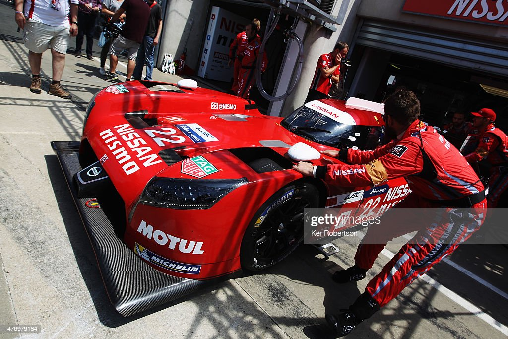 The Nissan NISMO GTR LM of Harry Tincknell Michael Krumm and Alex Buncombe is wheeled from its garage before the Le Mans 24 Hour race at the Circuit...