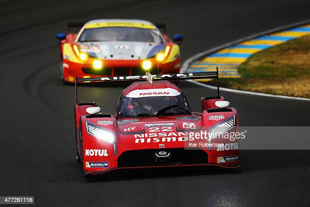 The Nissan NISMO GTR LM of Harry Tincknell Michael Krumm and Alex Buncombe drives during the Le Mans 24 Hour race at the Circuit de la Sarthe on June...