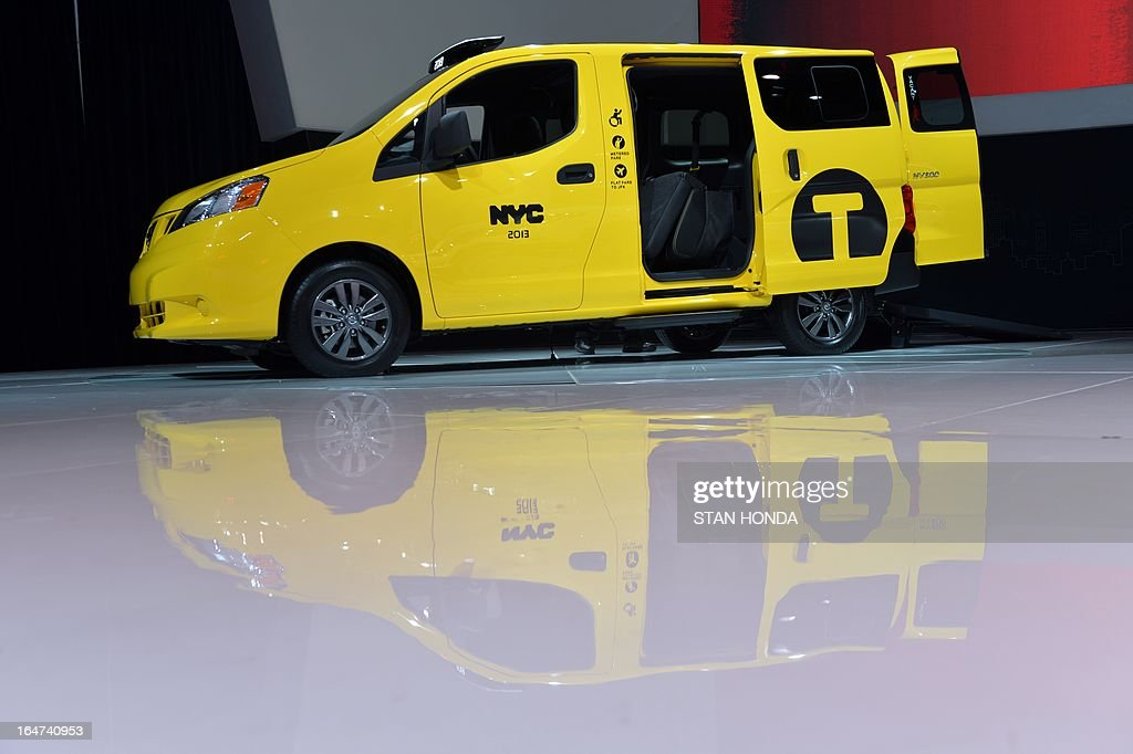 The Nissan NV 200 Mobility Taxi, built for New York City taxis, on display during the first press preview day at the New York International Auto Show March 27, 2013 in New York. AFP PHOTO/Stan HONDA