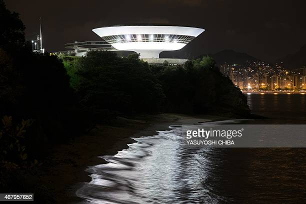 The Niteroi Contemporary Art Museum is lit up before the Earth Hour environmental campaign in Niteroi a neighbouring city of Rio de Janeiro Brazil on...
