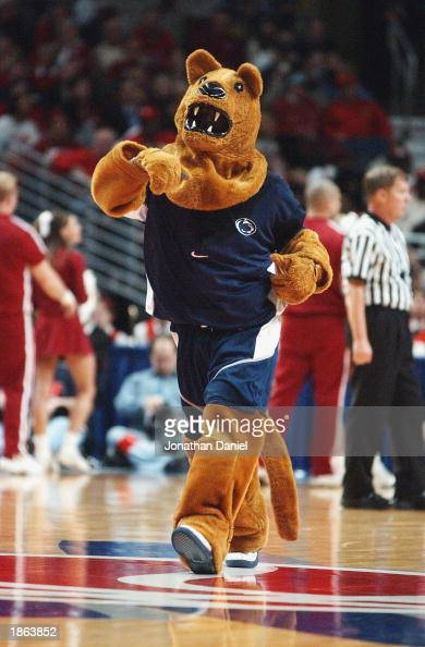The Nittany Lion mascot entertains the audience during an intermission in the Big Ten Men's Basketball Tournament between the Indiana University...