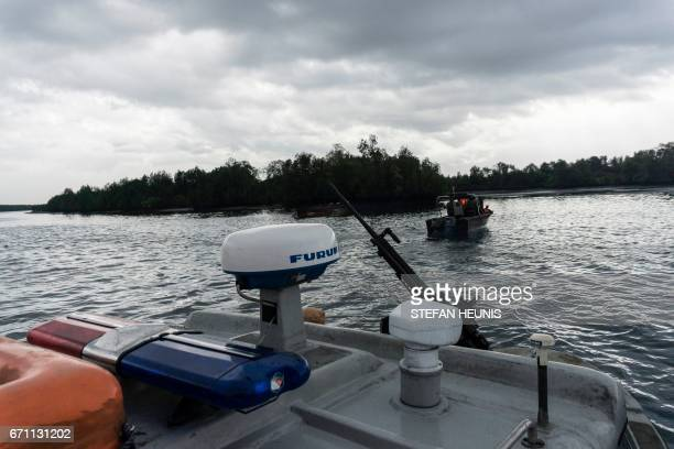 The NNS Pathfinder of the Nigerian Navy forces are out on patrol looking for illegal oil refineries on April 19 2017 in the Niger Delta region near...