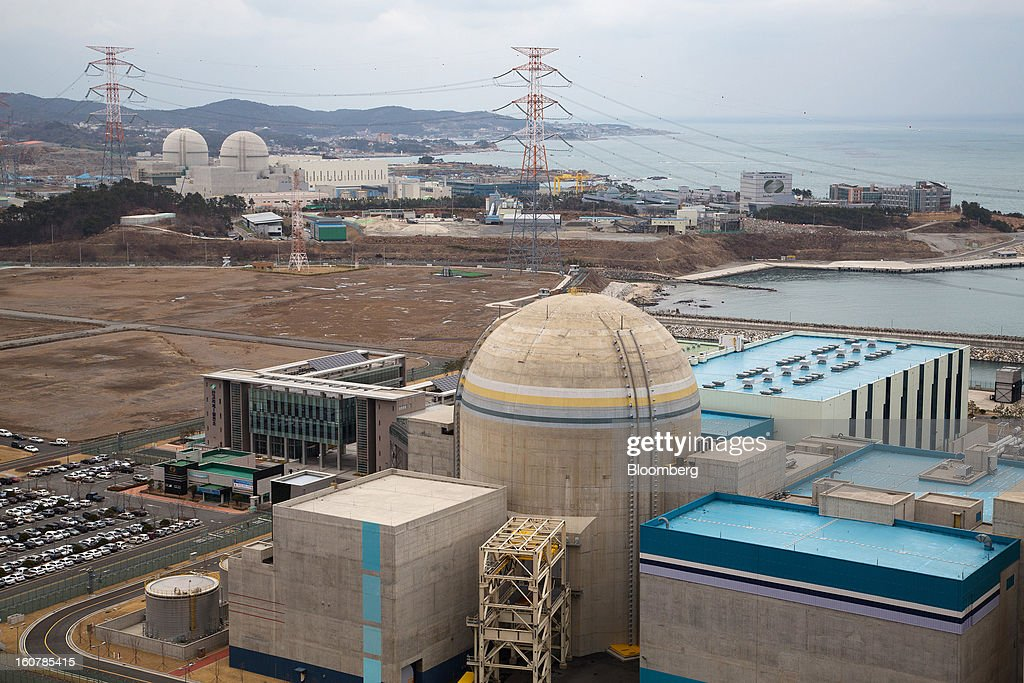 The No. 2 reactor building, front, stands at Korea Hydro & Nuclear Power Co.'s Shin-Kori nuclear power plant while the No. 4, background left, and No. 3 reactor buildings stand under construction in Ulsan, South Korea, on Tuesday, Feb. 5, 2013. Korea Hydro, a unit of Korea Electric Power Corp. (Kepco), operates 23 reactors in the country. Photographer: SeongJoon Cho/Bloomberg via Getty Images
