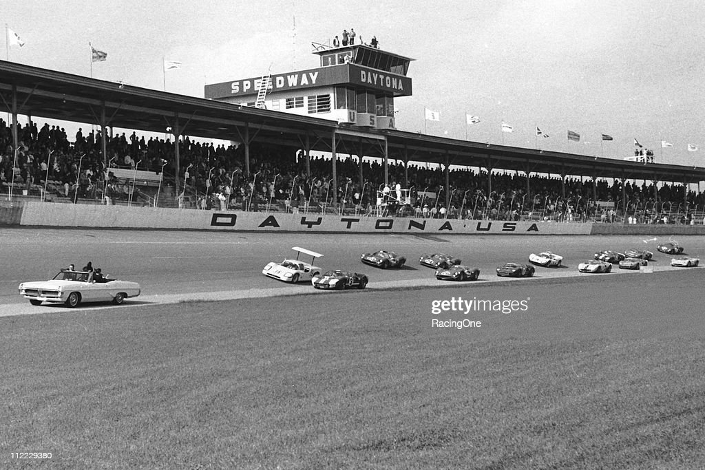 The No 3 Ford MK II of A J Foyt / Dan Gurney and the No 15 Chaparral 2F of Phil Hill / Jim Hall / Mike Spence lead a trio of Ferrari 330s during the...