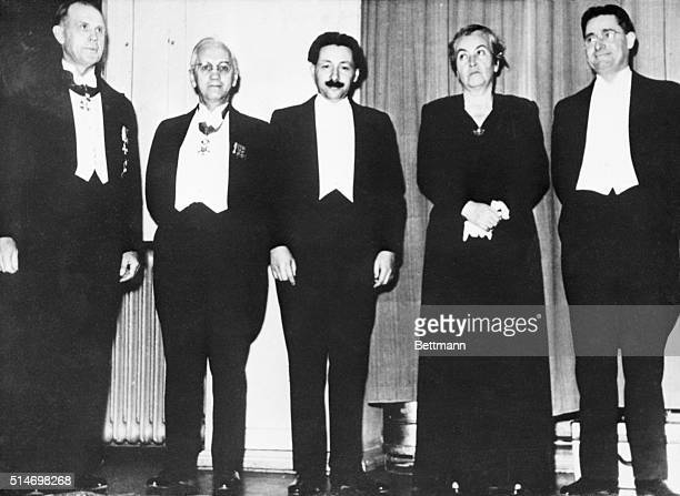The Nobel Prize winners for 1945 are left to right Artturi Virtanen for Chemistry Alexander Fleming and Ernst Boris Chain for Medicine Gabriela...