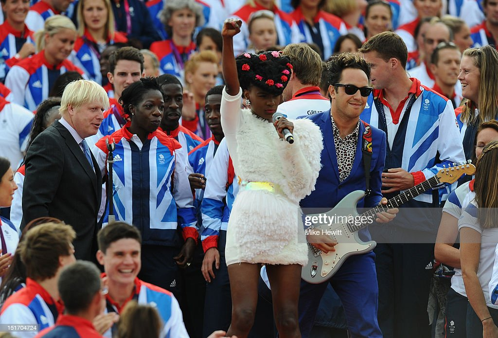 The <a gi-track='captionPersonalityLinkClicked' href=/galleries/search?phrase=Noisettes&family=editorial&specificpeople=5906750 ng-click='$event.stopPropagation()'>Noisettes</a> are watched by Mayor of London <a gi-track='captionPersonalityLinkClicked' href=/galleries/search?phrase=Boris+Johnson&family=editorial&specificpeople=209016 ng-click='$event.stopPropagation()'>Boris Johnson</a> during the Olympics & Paralympics Team GB London 2012 Victory Parade on September 10, 2012 in London, England.
