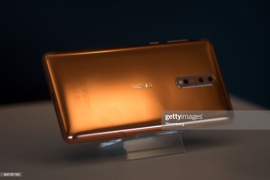 The Nokia 8 smartphone, designed by HMD Global Oy, sits on a stand ahead of its official unveiling in London, U.K., on Tuesday, Aug. 15, 2017. The phone will feature a dual-sight photo and video function, in which images from the front and rear cameras will be displayed simultaneously on a split screen. Photographer: Simon Dawson/Bloomberg via Getty Images