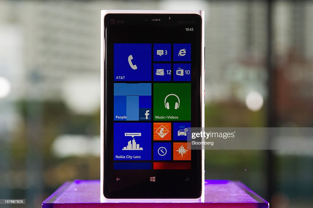 The Nokia Oyj Lumia 920 smartphone is displayed for a photograph in San Francisco, California, U.S., on Wednesday, Dec. 5, 2012. How should we think about the Nokia Lumia 920 and HTC 8X? Should we view them as the twin flagships of Microsoft's new Windows Phone 8 operating system? By that standard, they're impressive: two polished, highly capable new devices that show off Microsoft's colorful, innovative software to great effect. Photographer: David Paul Morris/Bloomberg via Getty Images