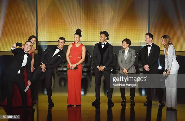 The nominees for the major awards pose for a 'selfie' with host James Nesbitt on the stage during the FIFA Ballon d'Or Gala 2015 at the Kongresshaus...
