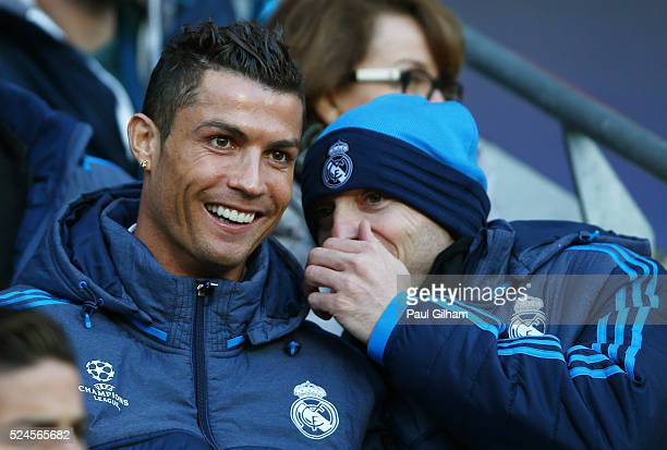 The non playing Cristiano Ronaldo of Real Madrid CF shares a joke with a teammate during the UEFA Champions League Semi Final first leg match between...