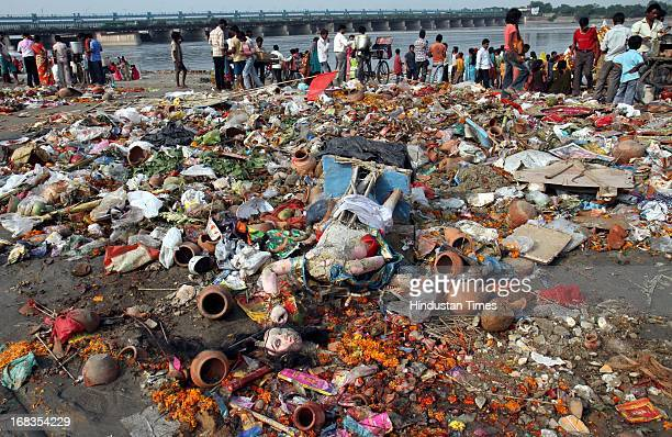 The nonbiodegradable festival accessories of the Goddess Durga idols spread all over the bank of Yamuna after the Immersion of clay Idols at Kalindi...