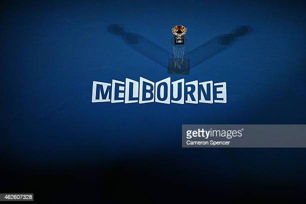 The Norman Brookes Challenge Cup is lowered into Rod Laver Arena ahead of the men's final match during day 14 of the 2015 Australian Open at...