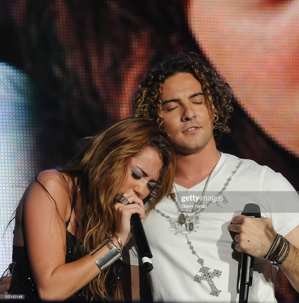 The North American singer Miley Cyrus, protagonist of 'Hannah Montana' and the top Spanish singer David Bustamente during a concert in 'Rock and Rio', 6th Juni 2010, Arganda Del Rey, Madrid, Spain.