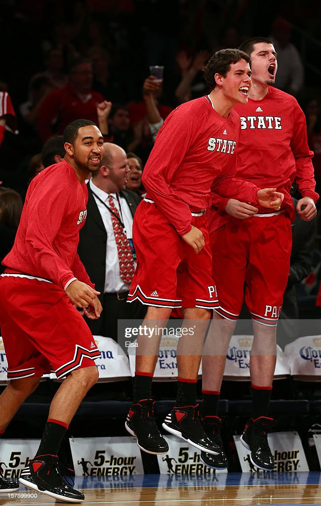 The North Carolina State Wolfpack bench celebrates in the second half against the Connecticut Huskies during the Jimmy V Classic on December 4, 2012 at Madison Square Garden in New York City. The North Carolina State Wolfpack defeated the Connecticut Huskies 69-65.
