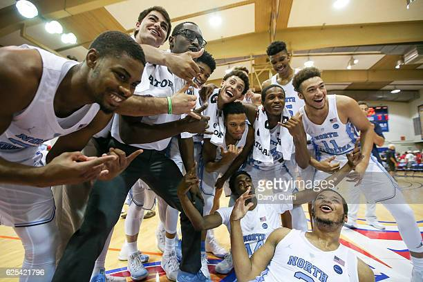 The North Carolina Tar Heel players pose for a photo after winning the championship game of the Maui Invitational against the Wisconsin Badgers at...