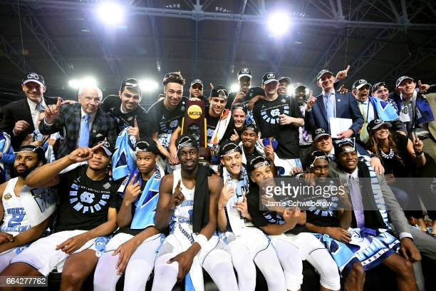 The North Carolina Tar Heels basketball team pose with their trophy during the 2017 NCAA Men's Final Four National Championship game against the...