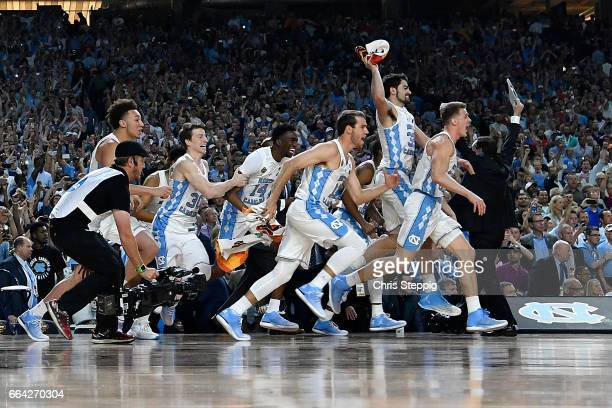 The North Carolina Tar Heels basketball team run on to the court after time expires during the 2017 NCAA Men's Final Four National Championship game...