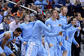 The North Carolina Tar Heels bench reacts in a win against the Louisville Cardinals during the quarterfinals of the ACC Basketball Tournament at...